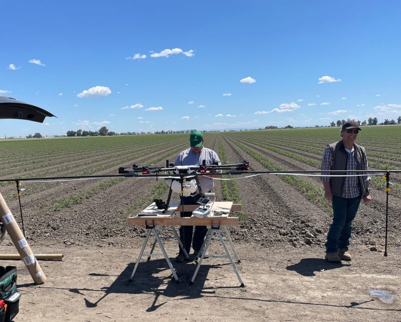 Rantizo preparing drone for foliar applications on tomato crops in California farm field